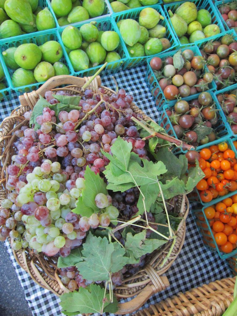 grapes with leaves in a basket