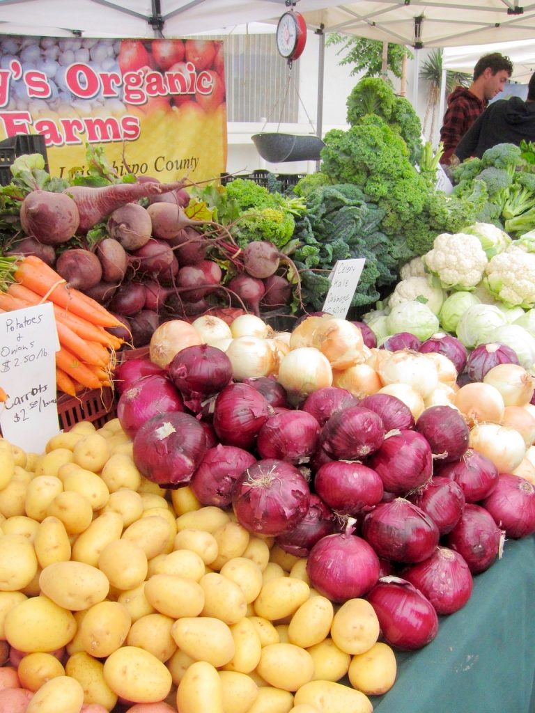 red onions at the farmers market